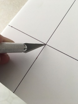 Step two was to cut the two inch square out from each of the corners.
