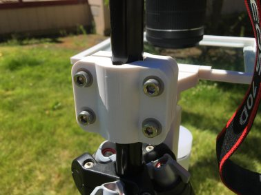 A specially designed clamp holds everything to the tripod.