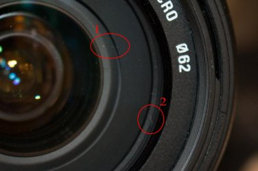 The two most prominent scratches on the sigma lens.